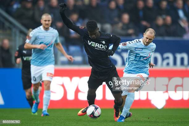 Mayron George of Randers FC and Sakari Mattila of SonderjyskE compete for the ball during the Danish Alka Superliga match between SonderjyskE and...