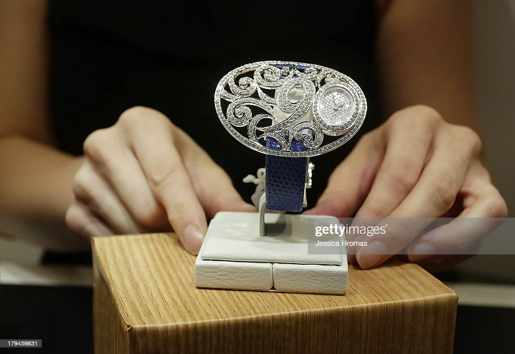 May's ladies watch in white gold with 334 diamonds, valued at USD $38,000 is displayed at the Hong Kong Watch & Clock Fair on September 4, 2013 in Hong Kong, Hong Kong.