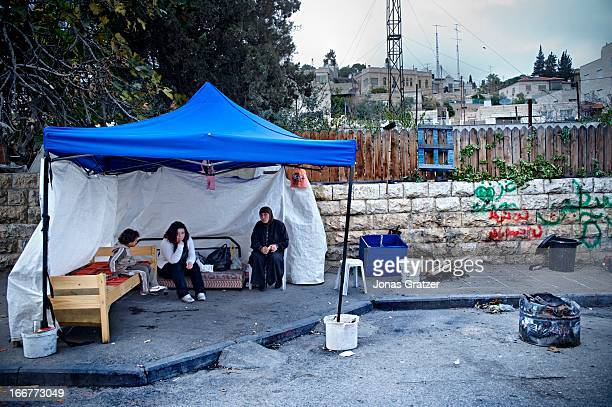 Maysoon Giwa sits with her children in their temporary home which is a tent in the street The Giwas a Palestinian family of 7 in East Jerusalem were...