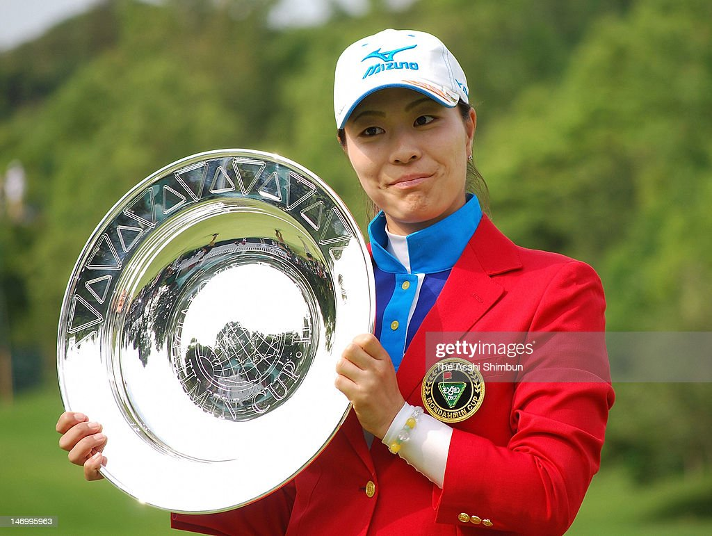 Mayu Hattroi poses for photographs with the trophy after winning the Earth Mondahmin Cup at Camellia Hills Country Club on June 24, 2012 in Sodegaura, Chiba, Japan.