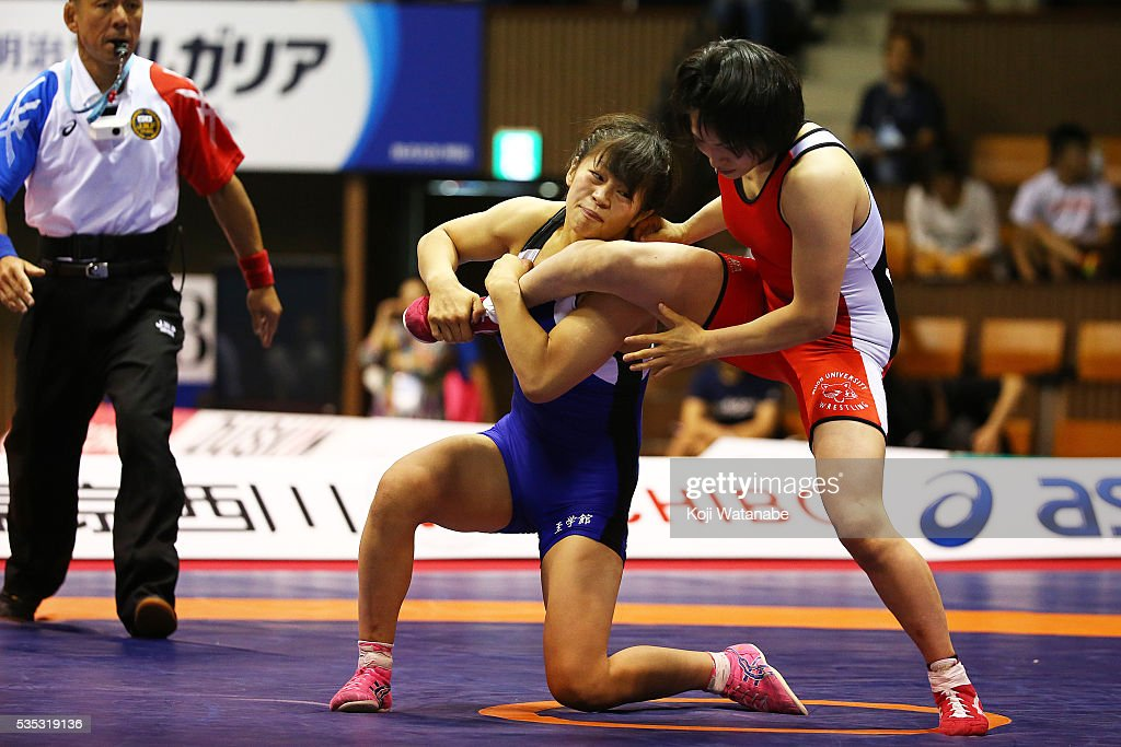 Mayu Mukaida (blue) competes in the Women's 53kg free style final match against Yuka Yago (red) during the All Japan Wrestling Championships at Yoyogi National Gymnasium on May 29, 2016 in Tokyo, Japan.