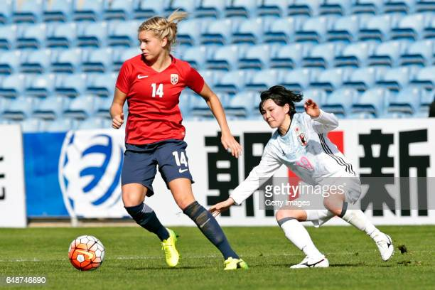 Mayu Sasaki of Japan challenges Ada Heperberg of Norway during the match between Norway v Japan Women's Algarve Cup on March 6 2017 in Loule Portugal