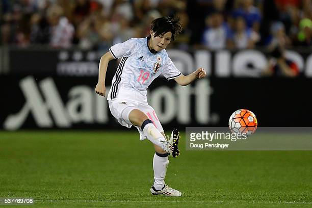 Mayu Sasaki of Japan passes the ball against the United States of America during an international friendly match at Dick's Sporting Goods Park on...