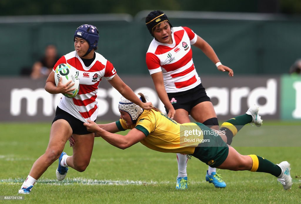 Mayu Shimizu of Japan is tackled by Sharni Williams of Australia during the Women's Rugby World Cup Pool C match between Australia and Japan at Billings Park UCD on August 17, 2017 in Dublin, Ireland.