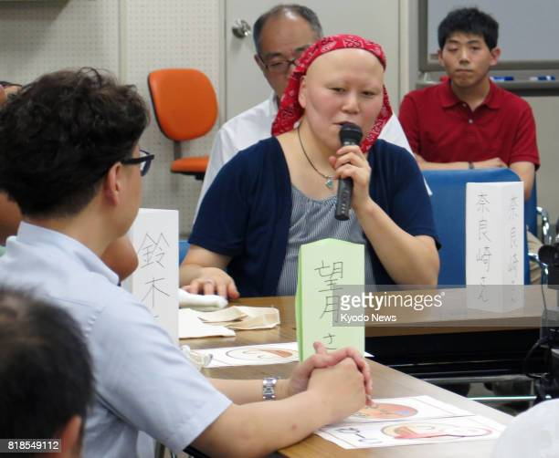Mayumi Narazaki a 39yearold intellectually disabled woman presides over a gathering in Yokohama Kanagawa Prefecture on July 8 to discuss an incident...