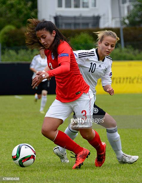 Mayumi Pacheco of England and Jenny Hipp of Germany during the UEFA European Women's Under17 Championship match between U17 Germany and U17 England...