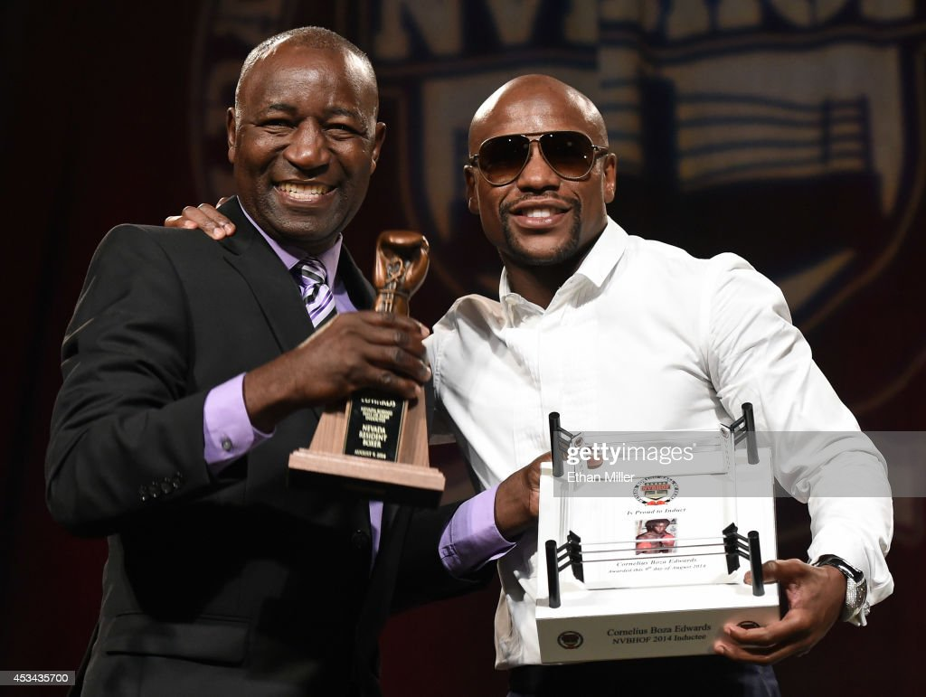 Mayweather Gym trainer and operator and former boxer Cornelius Boza-Edwards (L) is inducted into the Nevada Boxing Hall of Fame by WBC/WBA welterweight champion <a gi-track='captionPersonalityLinkClicked' href=/galleries/search?phrase=Floyd+Mayweather+Jr.&family=editorial&specificpeople=2294114 ng-click='$event.stopPropagation()'>Floyd Mayweather Jr.</a> during the second annual induction gala at the New Tropicana Las Vegas on August 9, 2014 in Las Vegas, Nevada. Mayweather was also honored as the Nevada Fighter of the Year.