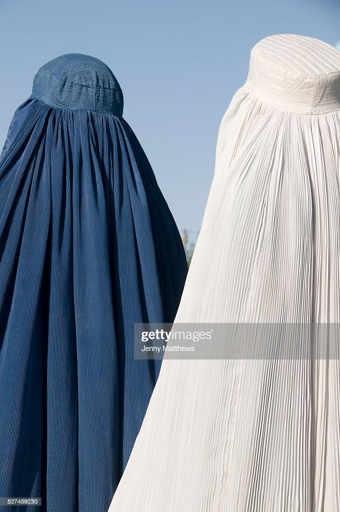 MazareSharif Afghanistan Shrine to Hazrat Ali Two women in burqas one white one blue