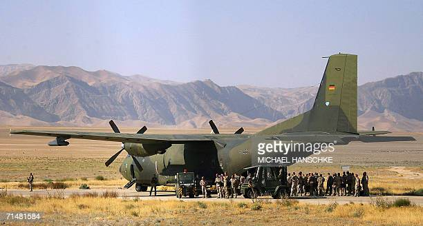 German soldiers of the NATOled International Security Assistance Force enter a Transall military plane at the airport of MazariSharif where German...