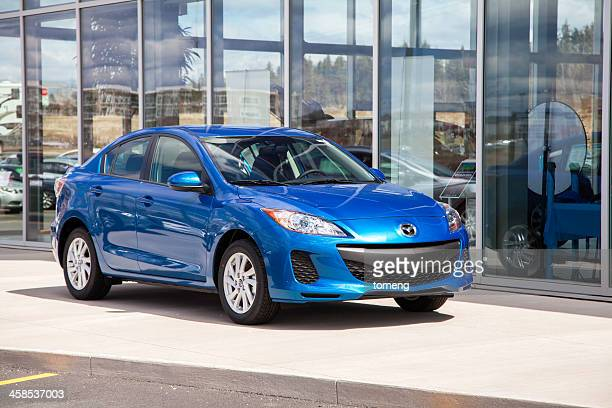 Mazda 3 in Front of Dealership