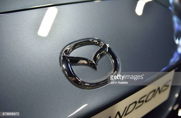 Mazda bonnet badge on display at the London Motor Show at Battersea Evolution on May 4 2017 in London England 41 dealerships and manufacturers will...