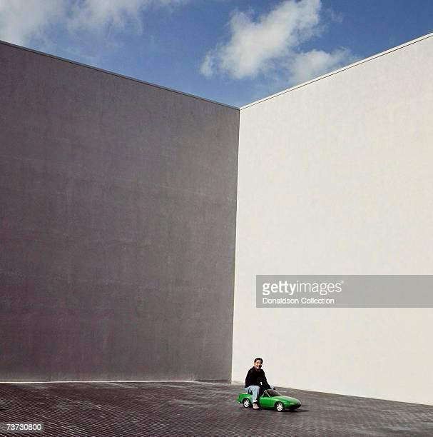Mazda car designer Tom Matano poses for a magazine shoot in 1995 at Mazda Headquarters in Orange County California