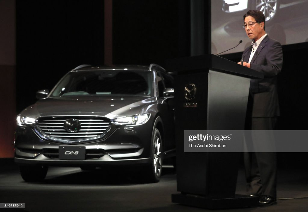 Mazda Motor Co President Masamichi Kogai introduces new SUV 'CX-8' during its unveiling on September 14, 2017 in Tokyo, Japan.