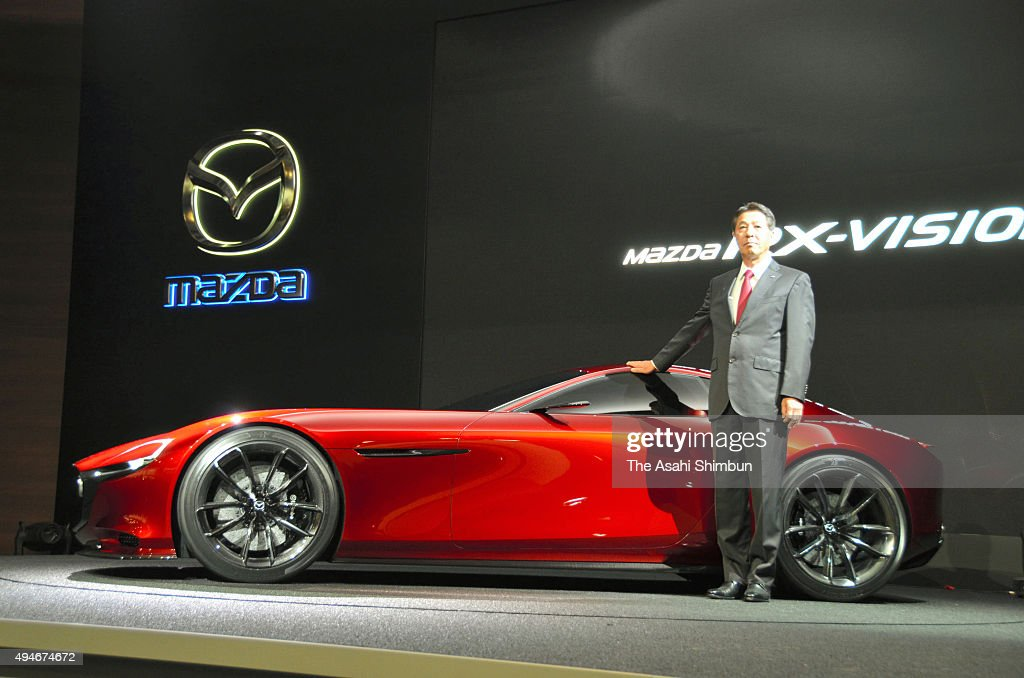 Mazda Motor Co President <a gi-track='captionPersonalityLinkClicked' href=/galleries/search?phrase=Masamichi+Kogai&family=editorial&specificpeople=10904432 ng-click='$event.stopPropagation()'>Masamichi Kogai</a> introduces the RX-Vision during the Tokyo Motor Show at Tokyo Big Sight on October 28, 2015 in Tokyo, Japan. 160 companies from 11 countries exhibit at the biennial motor show, which is open to public from October 30 to November 8.