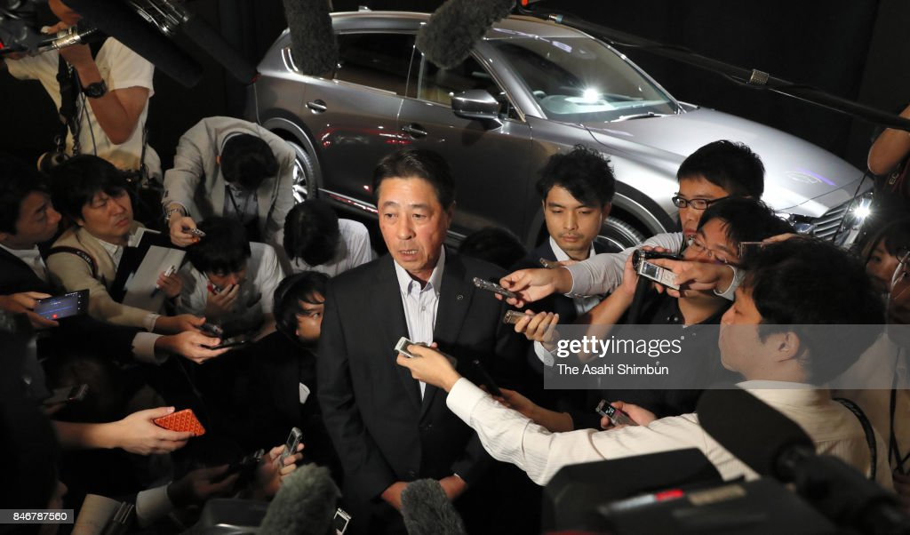Mazda Motor Co President Masamichi Kogai is surrounded by media reporters after the new SUV 'CX-8' unveiling on September 14, 2017 in Tokyo, Japan.