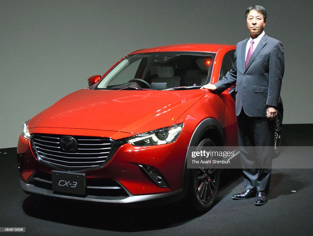 Mazda Motor Co President <a gi-track='captionPersonalityLinkClicked' href=/galleries/search?phrase=Masamichi+Kogai&family=editorial&specificpeople=10904432 ng-click='$event.stopPropagation()'>Masamichi Kogai</a> poses for photographs with new CX-3 sport-utility vehicle during its unveiling on February 27, 2015 in Tokyo, Japan.