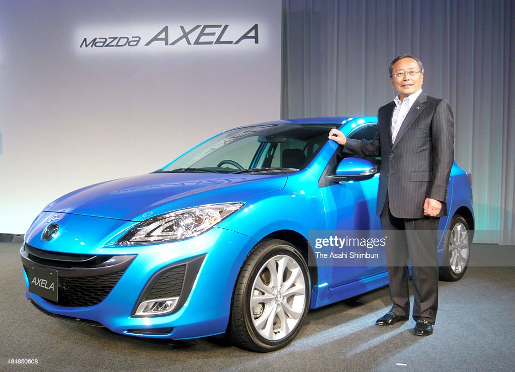 mazda Motor Co President Takashi Yamauchi introduces the company's hybrid vehicle 'Axela' during the unveiling on June 11, 2009 in Tokyo, Japan.