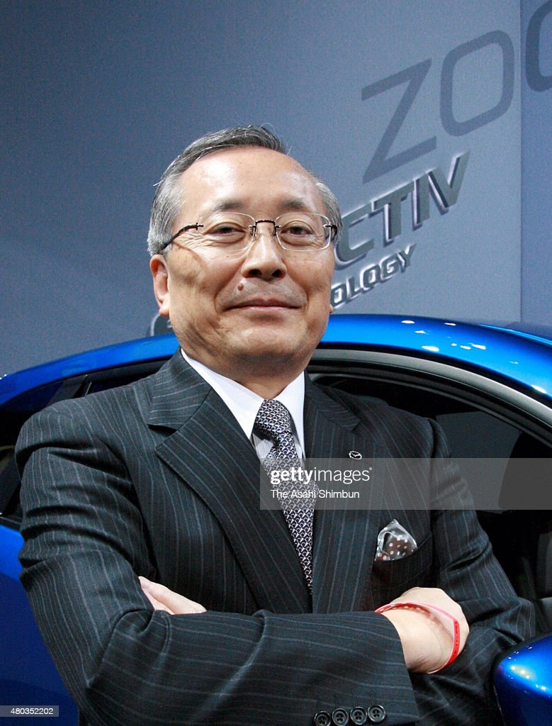 Mazda Motor Co President Takashi Yamauchi poses for photographs ahead of the Los Angeles Auto Show on November 16, 2011 in Los Angeles, California.