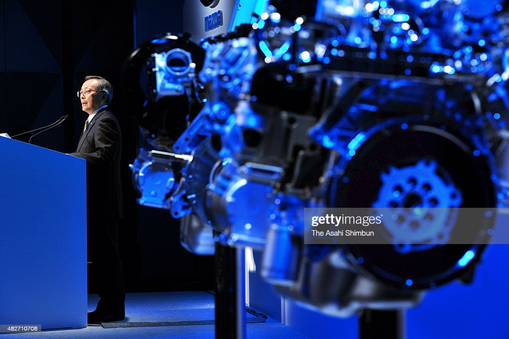 Mazda Motor Co President Takashi Yamauchi speaks during a press conference on the company's new generation engine on October 20, 2010 in Tokyo, Japan.