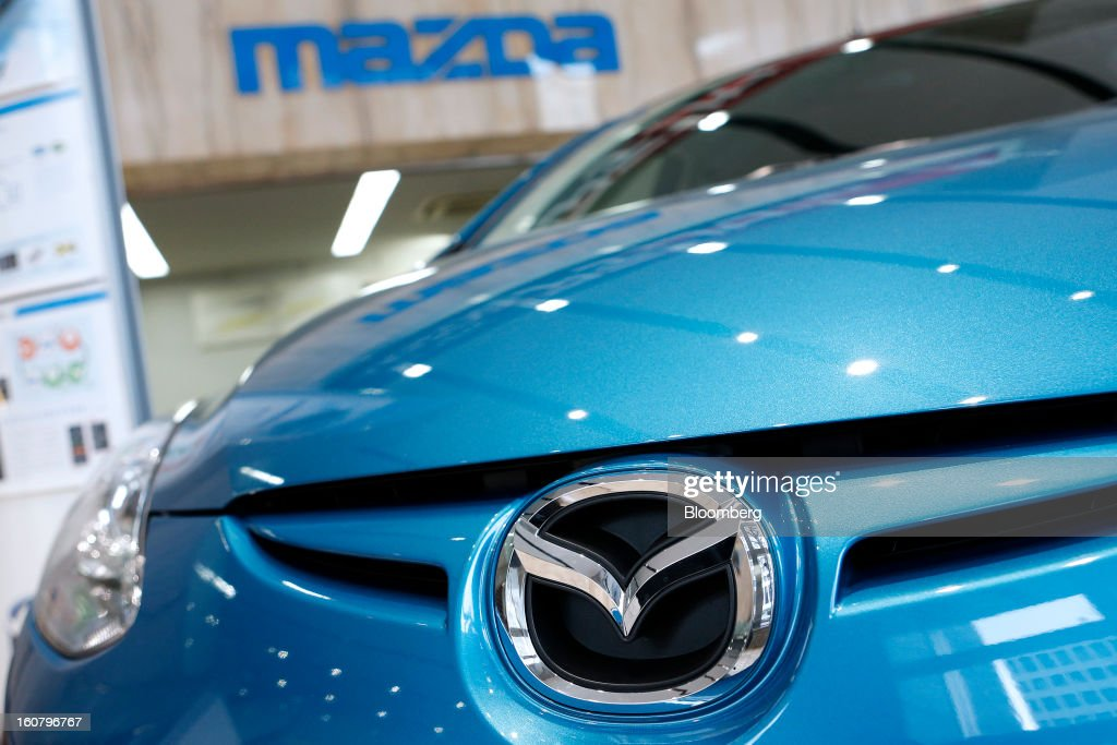 A Mazda Motor Corp. Demio compact vehicle stands on display at the company's showroom in Tokyo, Japan, on Wednesday, Feb. 6, 2013. Mazda, the best performer on the Nikkei 225 Stock Average in the past three months, more than doubled its full-year profit forecast on a weaker yen and demand for its fuel-efficient vehicles. Photographer: Kiyoshi Ota/Bloomberg via Getty Images