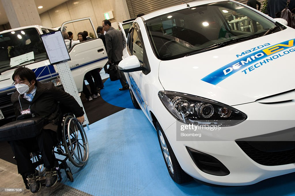 A Mazda Motor Corp. Demio EV vehicle is displayed at Automotive World 2013 in Tokyo, Japan, on Friday, Jan. 18, 2013. The Automotive World 2013 trade show ends today. Photographer: Noriko Hayashi/Bloomberg via Getty Images