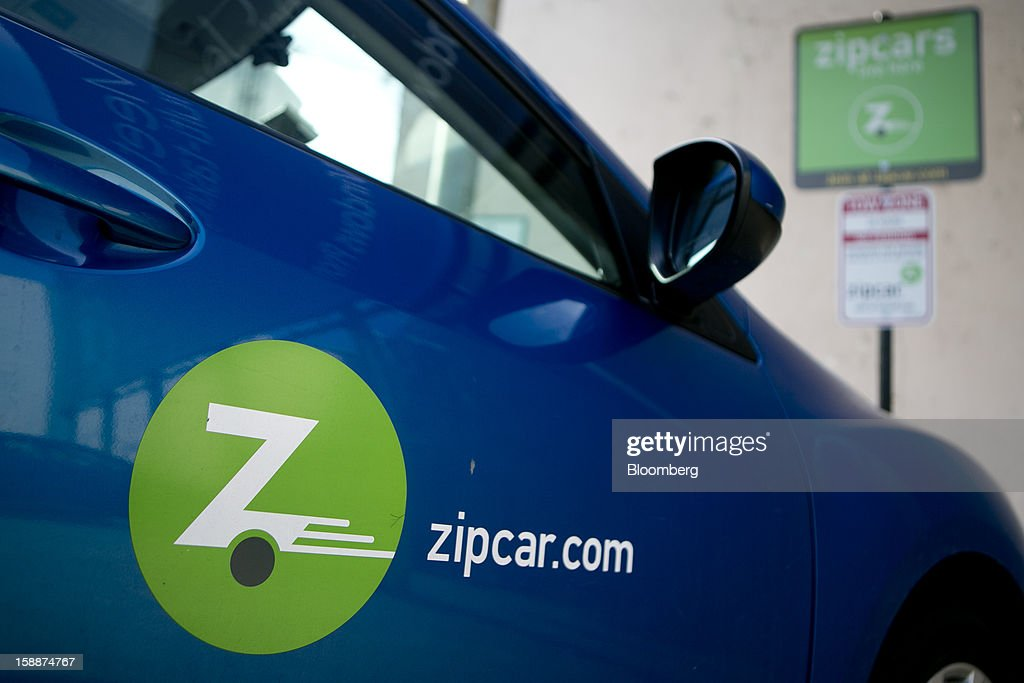 A Mazda Motor Corp. Zipcar Inc. vehicle sits parked in one of the company's spaces in Washington, D.C., U.S., on Wednesday, Jan. 2, 2013. Avis Budget Group Inc., once a skeptic about car sharing services, agreed to buy short-term rental pioneer Zipcar for $491 million, signaling a shift in the industry to embracing drivers who don't want to own cars. Photographer: Andrew Harrer/Bloomberg via Getty Images