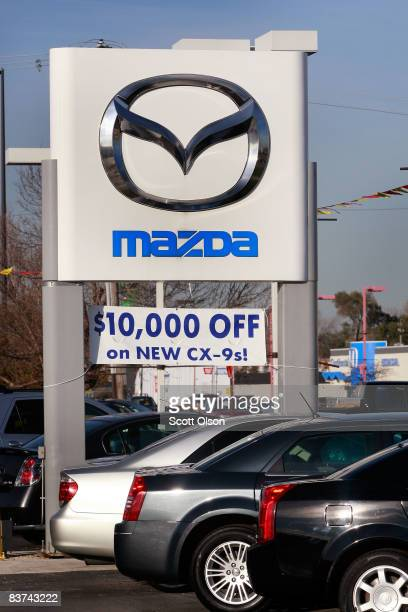 A Mazda sign marks the location of a Mazda dealership November 18 2008 in Countryside Illinois In an attempt to raise some desperately needed cash...