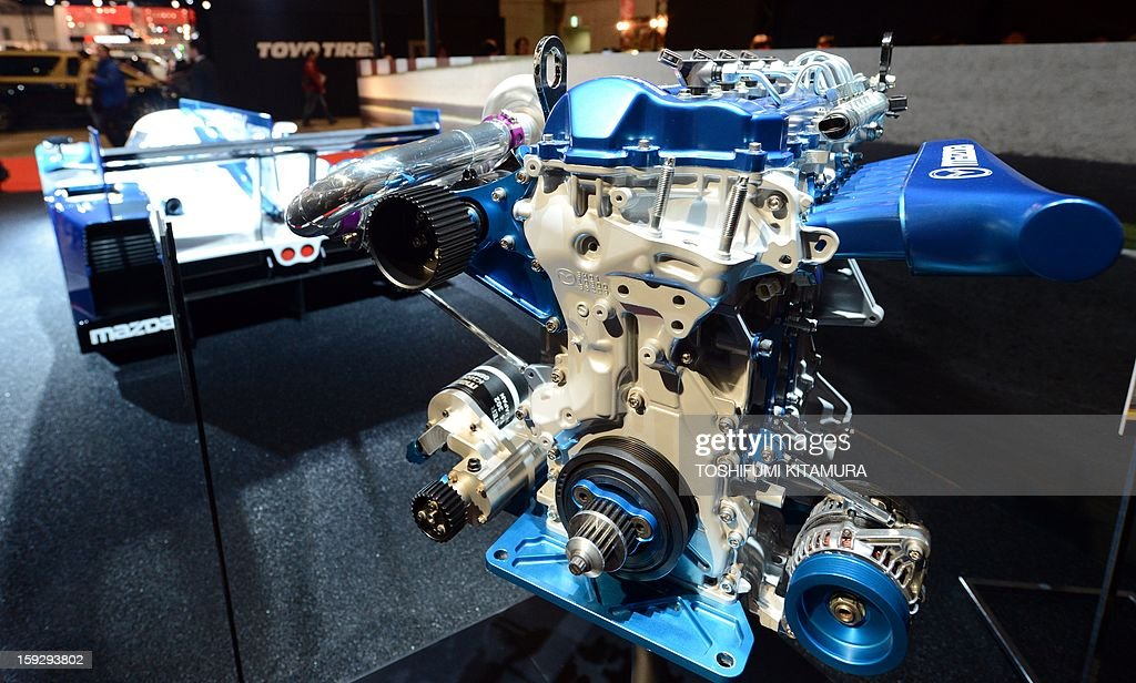 A Mazda 'SkyActive-D,' 2.2-litre 4-cylinder diesel racing engine for the LMP2-class Le Mans 24-hours endurance race is displayed during the Tokyo Auto Salon 2013 exhibition at the Makuhari Messe in Chiba on January 11, 2013. A total of 452 domestic and foreign companies participated in the three-day-long custom car exhibition with some 800 vehicles on display.