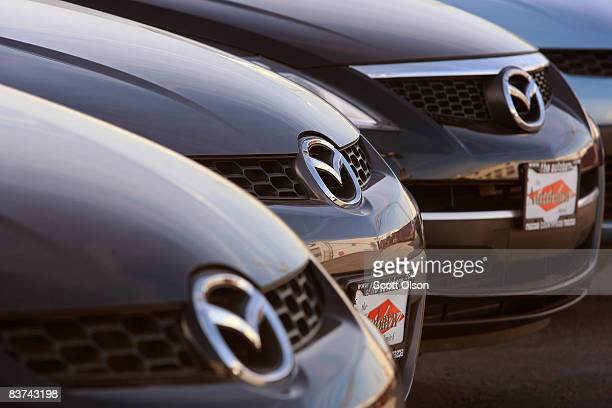 Mazda vehicles sit on the lot of a Mazda dealership November 18 2008 in Countryside Illinois In an attempt to raise some desperately needed cash Ford...
