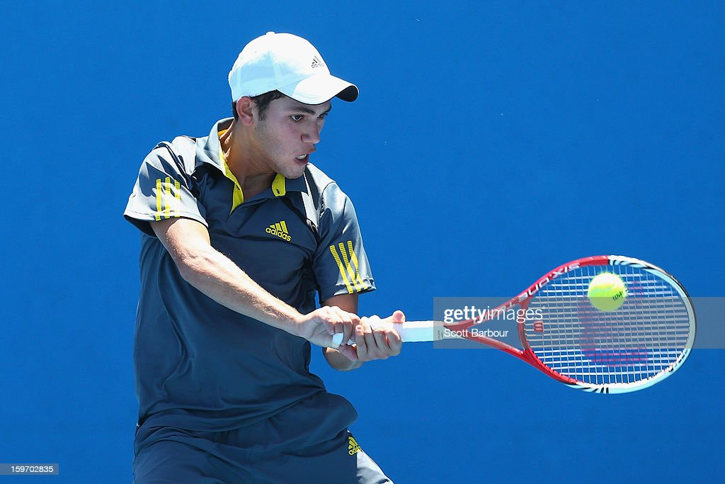 Mazen Osama of Egypt plays a backhand in his first round match Akira Santillan of Australia during the 2013 Australian Open Junior Championships at Melbourne Park on January 19, 2013 in Melbourne, Australia.