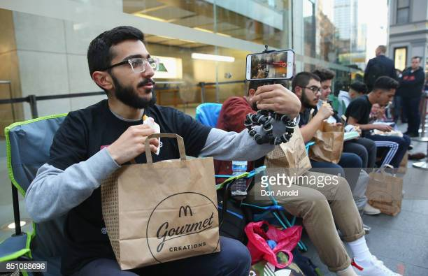 Mazzen Kaourouche who had been queueing for eleven days with his two friends films his every move before being allowed inside for the release of the...