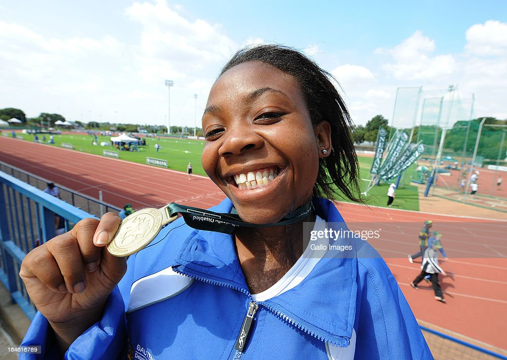 Mbali Madondo celebrates her Gold medal and Africa Record in the long jump during day 3 of The Nedbank National Championships for the Physically Disabled (Athletics) at LC de Villiers Stadium on March 25, 2013 in Pretoria, South Africa.