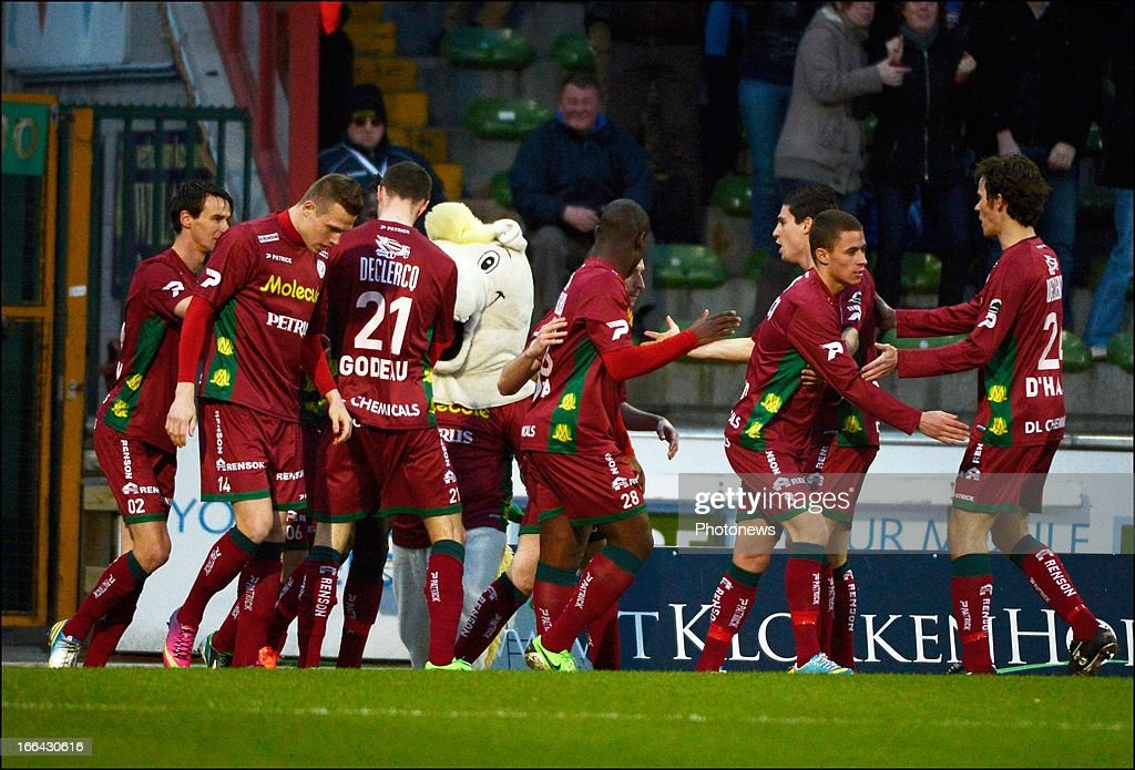 Mbaye Leye of Zulte-Waregem celebrates with teammates during the Jupiler League match play-off 1 between Zulte Waregem and Standard de Liege on April 12, 2013 in Waregem, Belgium.