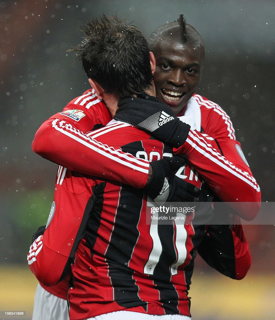 Mbaye Niang (R) and <a gi-track='captionPersonalityLinkClicked' href=/galleries/search?phrase=Giampaolo+Pazzini&family=editorial&specificpeople=800179 ng-click='$event.stopPropagation()'>Giampaolo Pazzini</a> of Milan celebrates during the TIM Cup match between AC Milan and Reggina Calcio at San Siro Stadium on December 13, 2012 in Milan, Italy.