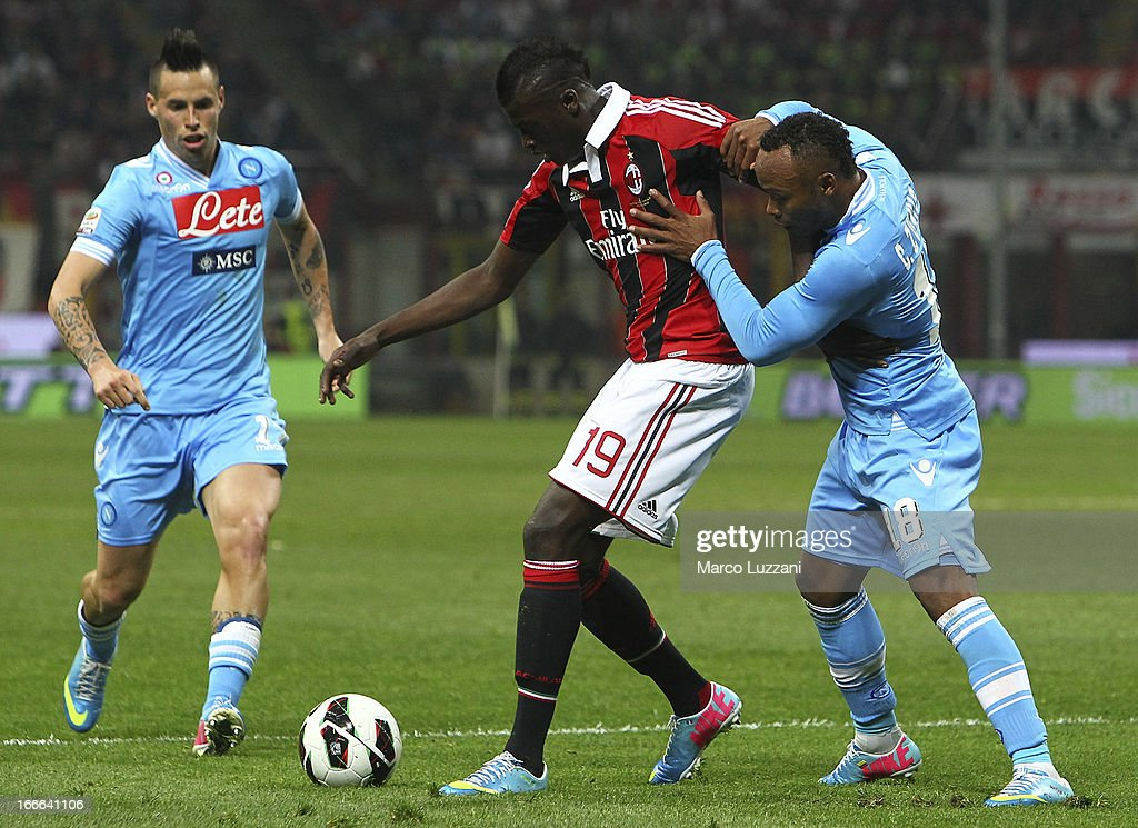 Mbaye Niang of AC Milan competes for the ball with Juan Camilo Zuniga of SSC Napoli during the Serie A match between AC Milan and SSC Napoli at San Siro Stadium on April 14, 2013 in Milan, Italy.