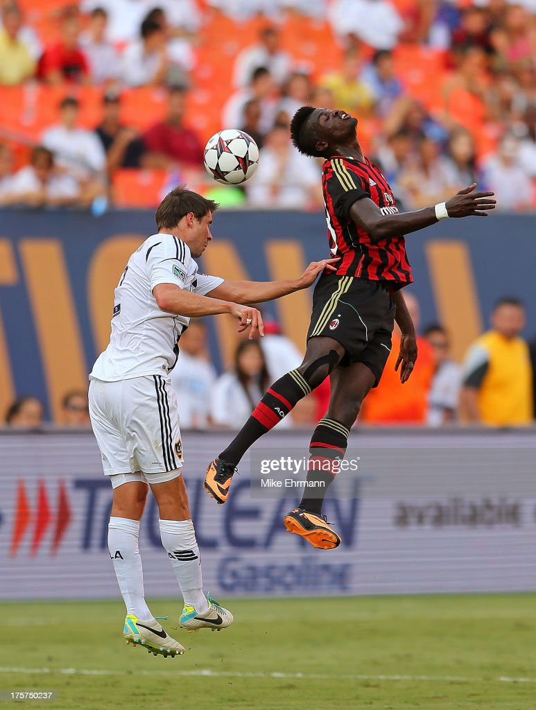 Mbaye Niang #78 of AC Milan goes for a header against Todd Dunivant #2 of Los Angeles Galaxy during the International Champions Cup Third Place Match at Sun Life Stadium on August 7, 2013 in Miami Gardens, Florida.