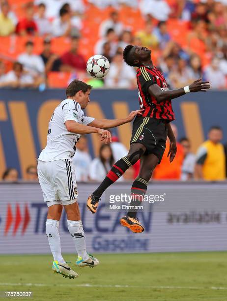 Mbaye Niang of AC Milan goes for a header against Todd Dunivant of Los Angeles Galaxy during the International Champions Cup Third Place Match at Sun...