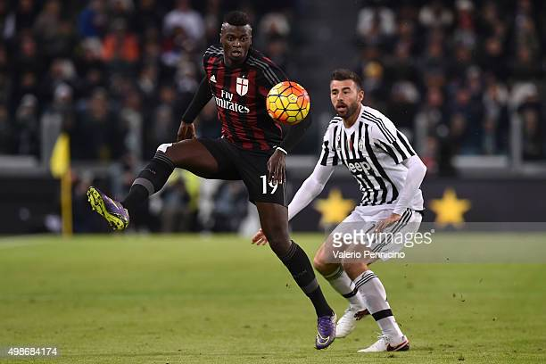 Mbaye Niang of AC Milan in action against Andrea Barzagli of Juventus FC during the Serie A match between Juventus FC and AC Milan at Juventus Arena...