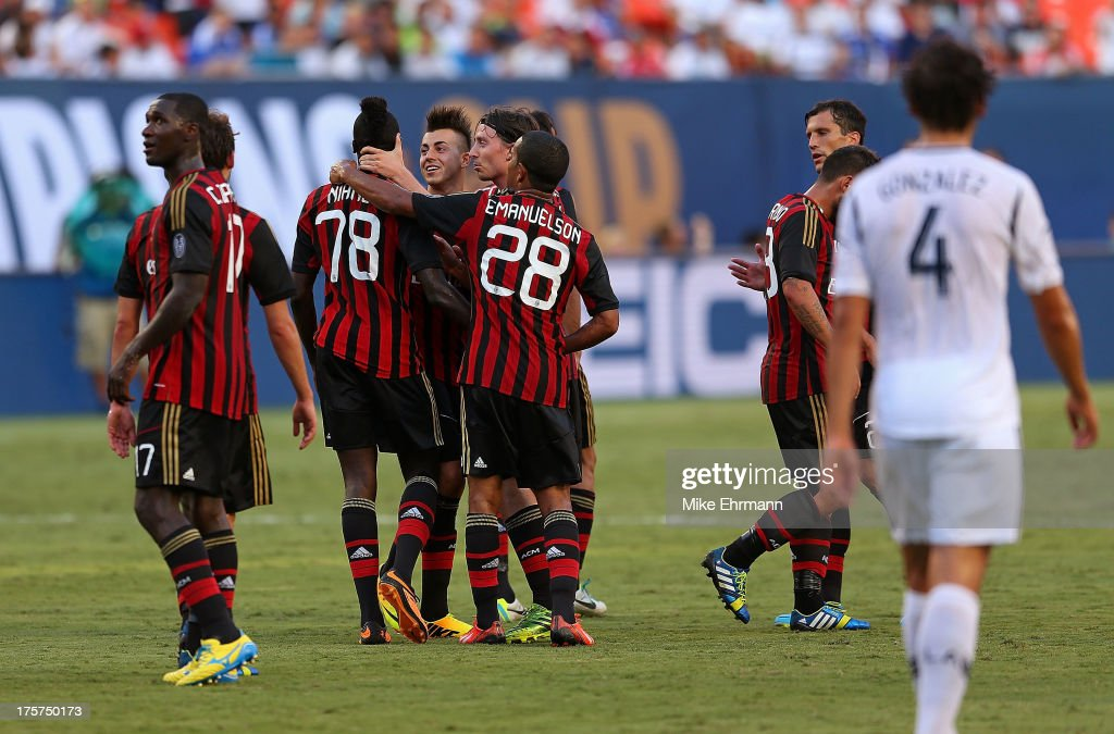 Mbaye Niang #78 of AC Milan is congratulated after scoring a goal against the Los Angeles Galaxy during the International Champions Cup Third Place Match at Sun Life Stadium on August 7, 2013 in Miami Gardens, Florida.