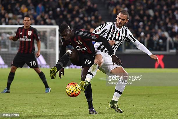 Mbaye Niang of AC Milan is tackled by Leonardo Bonucci of Juventus FC during the Serie A match between Juventus FC and AC Milan at Juventus Arena on...