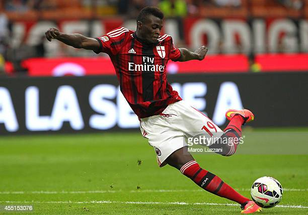 Mbaye Niang of AC Milan kicks a ball during the Serie A match between AC Milan and SS Lazio at Stadio Giuseppe Meazza on August 31 2014 in Milan Italy