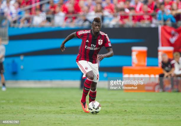 Mbaye Niang of AC Milan pushes the ball up the field during first half action against Liverpool in the Guinness International Champions Cup at Bank...