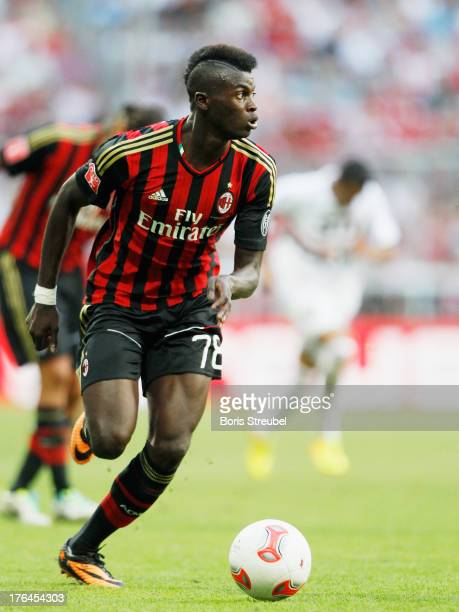 Mbaye Niang of Milan runs with the ball during the Audi Cup 2013 third place match between FC Sao Paulo and AC Milan at Allianz Arena on August 1...
