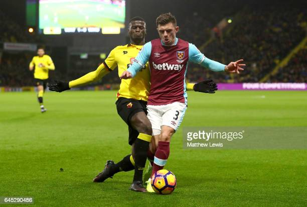 Mbaye Niang of Watford battles with Aaron Cresswell of West Ham United during the Premier League match between Watford and West Ham United at...