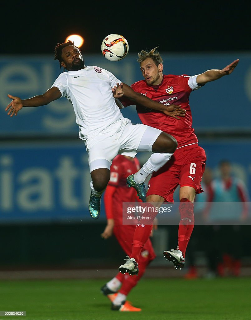 Mbilla Etame (L) of Antalyaspor is challenged by Georg Niedermeier of Stuttgart during a friendly match between VfB Stuttgart and Antalyaspor at Akdeniz Universitesi on January 7, 2016 in Antalya, Turkey.