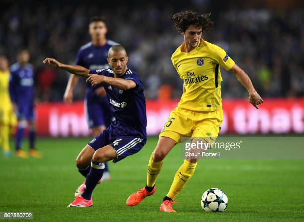Mbodji Kara of RSC Anderlecht and Adrien Rabiot of PSG battle for posession during the UEFA Champions League group B match between RSC Anderlecht and...