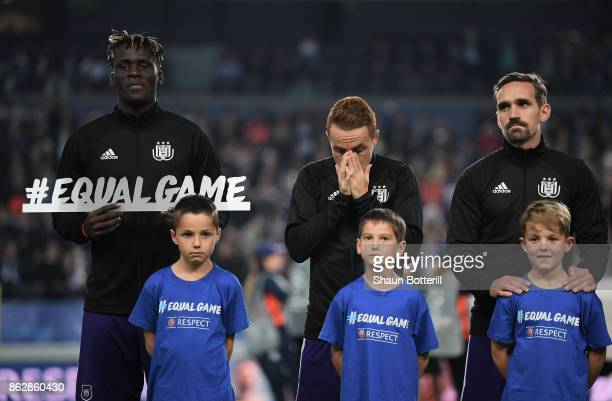 Mbodji Kara of RSC Anderlecht poses for a photo with the #EqualGame sign prior to the UEFA Champions League group B match between RSC Anderlecht and...