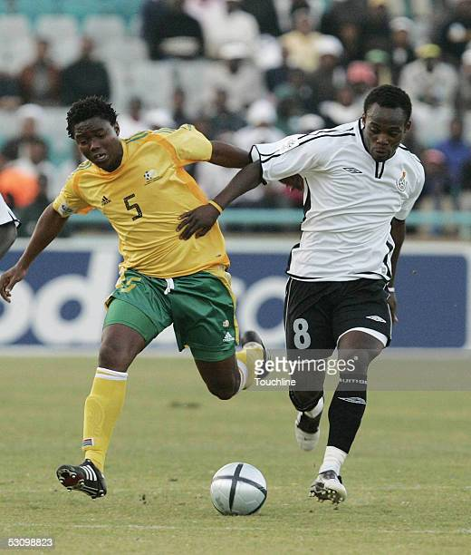 Mbulelo Mabizela of South Africa and Michael Essien of Ghana go for the ball during the World Cup Qualifier between South Africa and Ghana at the FNB...