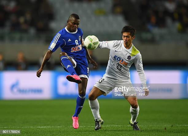 Mbwana Samatta of TP Mazembe is challenged by Tsukasa Shiotani of Sanfrecce Hiroshima during the the FIFA Club World Cup Quarter Final match between...