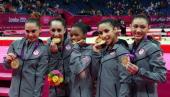 Mc Kayla Maroney Jordyn Wieber Gabrielle Douglas Alexandra Raisman and Kyla Ross of the United States celebrate after winning the gold medal in the...